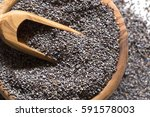 Poppy Seeds In A Wooden Bowl