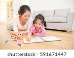 happy mixed race asian mother... | Shutterstock . vector #591671447