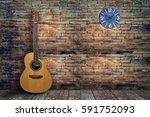 acoustic guitar in empty room...   Shutterstock . vector #591752093