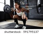 intense workout in dark gym ... | Shutterstock . vector #591795137