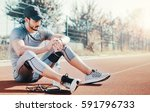 young sportsman checking his... | Shutterstock . vector #591796733