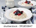 oatmeal porridge with blueberry ... | Shutterstock . vector #591853847