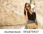 woman standing outside with a... | Shutterstock . vector #591875927