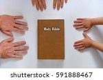 Small photo of family bible hands on a white background