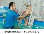baby relaxing in the swimming... | Shutterstock . vector #591906377