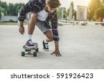 tattoo skater performing with... | Shutterstock . vector #591926423