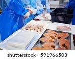 workers clean pieces of frozen... | Shutterstock . vector #591966503