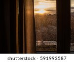 drops of rain on window after a ... | Shutterstock . vector #591993587
