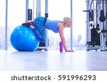 fitness woman training by... | Shutterstock . vector #591996293