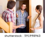 cheerful male guest saying... | Shutterstock . vector #591998963