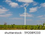 wind turbine on the blue sky... | Shutterstock . vector #592089233