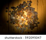 coins spread on the wooden... | Shutterstock . vector #592095047