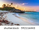 sunset on the beach of playa... | Shutterstock . vector #592116443