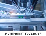 automatic robot in assembly... | Shutterstock . vector #592128767