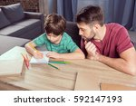 high angle view of father... | Shutterstock . vector #592147193