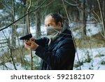 An Elderly Man With A Gun In...