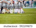coach giving young soccer team... | Shutterstock . vector #592199873