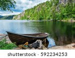 Wooden Boat On The Lake Bank O...