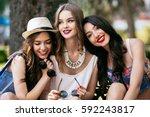 three beautiful young girls...   Shutterstock . vector #592243817
