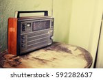 old radio on rustic background... | Shutterstock . vector #592282637