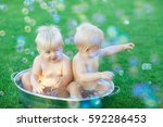 Twins Flop In A Basin With...