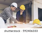 professional asian engineers... | Shutterstock . vector #592406333