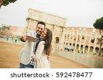 young couple taking selfie in... | Shutterstock . vector #592478477