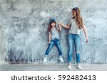 young beautiful mom with her... | Shutterstock . vector #592482413