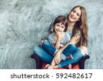 young beautiful mom with her... | Shutterstock . vector #592482617