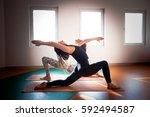 two young women doing yoga ... | Shutterstock . vector #592494587