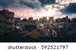sunset over buildings in the... | Shutterstock . vector #592521797