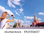 travel and technology. young... | Shutterstock . vector #592550657