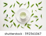 cup of fresh green tea with... | Shutterstock . vector #592561067