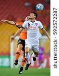 Small photo of Naoaki Aoyama (white) of Muangthong United in action during the AFC Champions League between Brisbane Roar and Muangthong United at Suncorp Stadium on February 21, 2017 in Australia.