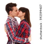 Small photo of Teenage couple kissing, isolated on white background