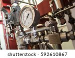 pressure gauge install at pipe... | Shutterstock . vector #592610867