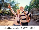 travel and tourism. senior... | Shutterstock . vector #592615847