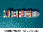 container ship in export and... | Shutterstock . vector #592641083