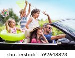 a joyful family  in a... | Shutterstock . vector #592648823