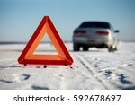 car accident on winter road.... | Shutterstock . vector #592678697
