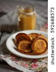 Small photo of orange muffins in a plate on the table (a few pieces)