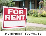 blank for rent sign posted in... | Shutterstock . vector #592706753