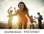 group of friends having fun on... | Shutterstock . vector #592725467