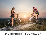 cyclist couple with mountain... | Shutterstock . vector #592781387