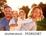 happy family with male and... | Shutterstock . vector #592802387