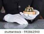 close up of a waiter hand...   Shutterstock . vector #592862543