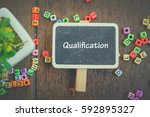 word qualification on wooden...   Shutterstock . vector #592895327