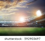 stadium in lights and flashes... | Shutterstock . vector #592903697