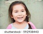 charming latin little girl... | Shutterstock . vector #592938443