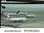 Small photo of Austrian Airlines and Singapore Airlines taxiing pass Emirates airline and Thai Airways airlines in Suvarnabhumi International Airport in Bangkok, Thailand. April 14, 2014